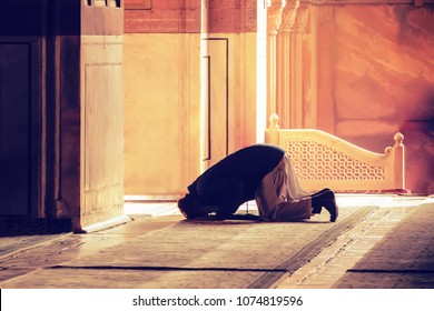 The muslim prayer for god in the mosque. Old iranian Muslim is on his knees praying. Holy month of Ramadan Muslims. Moslem, mohammedan, muslimah. monk, friar, monastic,