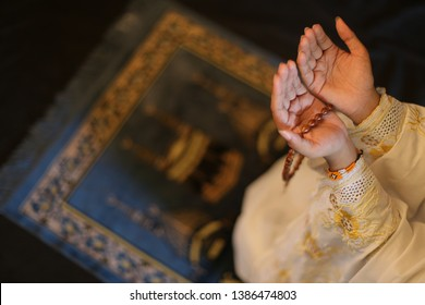 muslim prayer hand on ramadan kareem.