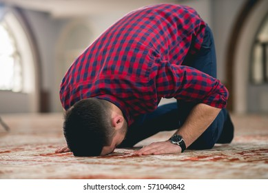 Muslim praying on the ground