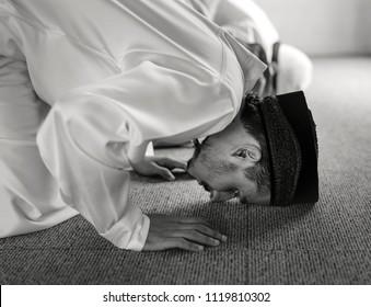 Muslim praying in Sujud posture