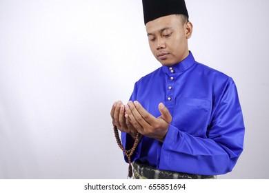Muslim Praying with Tasbih