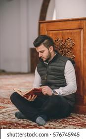 Muslim reading holy book Koran