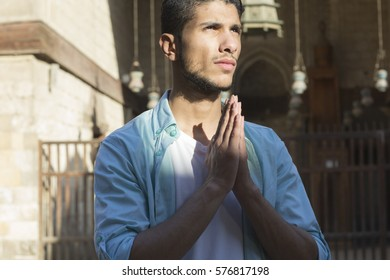 Muslim Saudi Arabian Arabic young man model praying at mosque as visitor in Egyptian mosque in Cairo, Egypt, middle east Africa