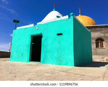 """Muslim Tomb in Moula Abdelkader Moul El Mayda, Oran, Algeria written """"Allah"""" (The God) text on tiles with Arabic letters on it."""