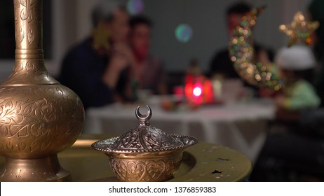 Muslim traditional family together having dinner on table at home. Fasting and Breaking Fast During Ramadan