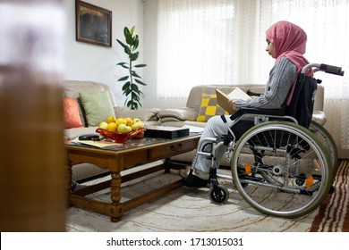 Muslim wheelchaired female reading book