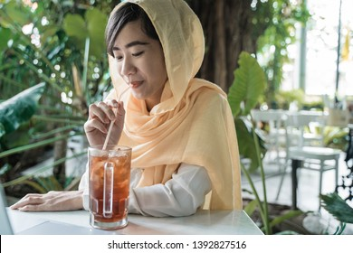 muslim woman break fasting in cafe. buka puasa concept