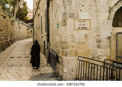 Muslim woman covered, in via Dolorosa checkpoint, Jerusalem