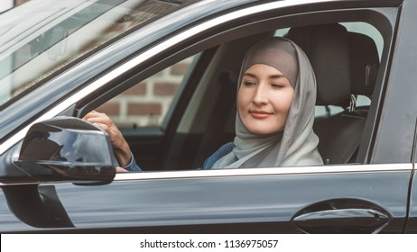 Muslim woman is driving a car