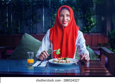 muslim woman enjoying her food after sunset in Ramadan