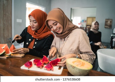 muslim woman friend preparing some fruit dessert cocktail for break fasting in the kitchen