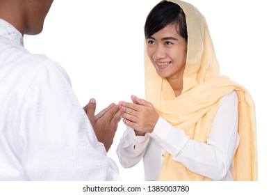 muslim woman hand touching shake hand apologizing on idul fitri
