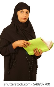 Muslim woman holding a book