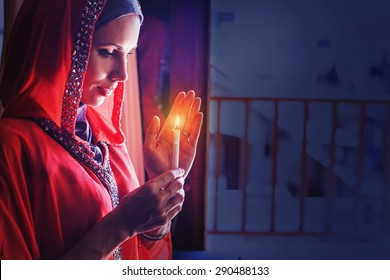 muslim woman holding candle in a ramadan night