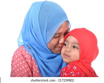 Muslim woman kissing her daughter. Love concept