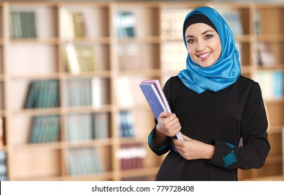 Muslim woman with notebooks