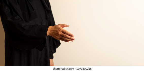 Muslim woman offering a handshake close up
