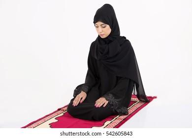 muslim woman praying on white background