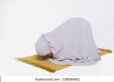 Muslim woman praying in Sujud posture