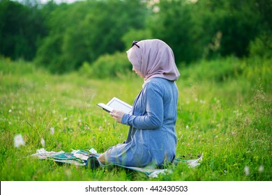 Muslim woman reading on the nature of the Quran.