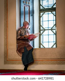 Muslim woman reading quran in mosque