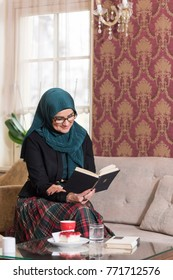 Muslim woman relaxing in a caffee