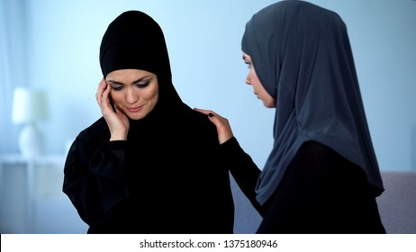 Muslim woman supporting female friend suffering from gender discrimination