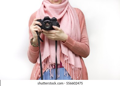 Muslim woman taking a photography with a vintage slr camera, no face