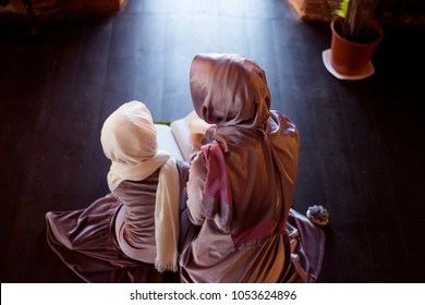 Muslim woman teaches children to read the Quran