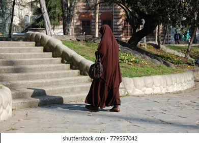 Muslim woman in traditional clothes jilbab