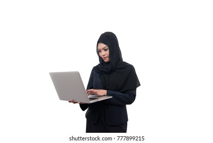 Muslim woman is using laptop isolated on white background.