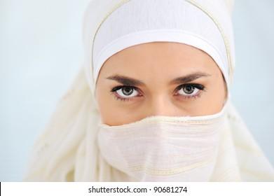 Muslim woman with veil looking at camera