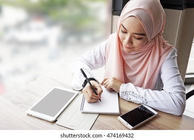 muslim woman working.