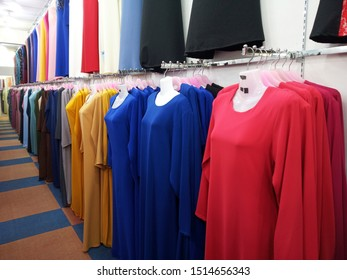 Muslim women attire, This dress is on call Baju Kurung. A variety of Baju Kurung designs are on display to make it easier for customers to make choices