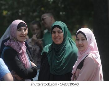 Muslim women during the Kiyv East Fest festival dedicated to the Islamic holiday Ramazan Bayram in Taras Shevchenko Park, in Kiev, June 5, 2019