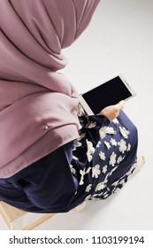 Muslim women holding a smartphone