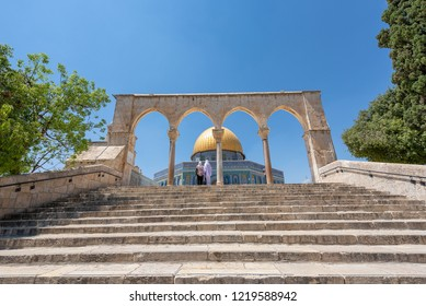 Muslim women looking at the Dome of the Rock. It is an Islamic shrine located on the Temple Mount in the Old City of Jerusalem.