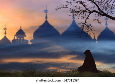Muslim women pray earnestly East peace background blur mosque, Islam is the religion, hijab and parents lifestyle ,1443 Ramadan festival concept,Concept person dua religious devout ,Women's Day