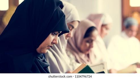 Muslim women reading Quran in the mosque during the Ramadan