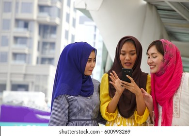 Muslim women is spending good time together in university.