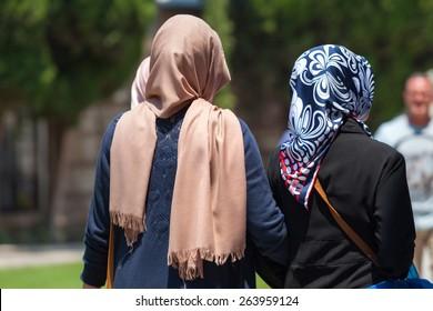 Muslim women walking in a park