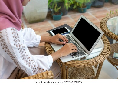 muslim women wearing White clothes working outside the office with laptop communication technology,concept  businesswoman workplace management professional