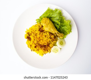 Muslim yellow rice with chicken ( Chicken Biryani ).