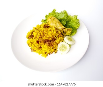 Muslim yellow rice with chicken ( Chicken Biryani ).