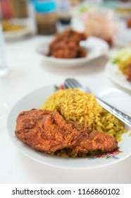 muslim yellow rice with chicken,halal food yellow rice with chicken leg ,Arabian rice kabsa, Ramadan food in middle east