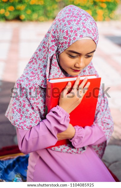 Muslim young women reading quran in mosque  Muslim people respect islam  Islam is religion