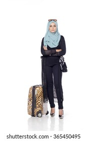 muslimah asian woman with her trolly bag wating and posing for people isolated in white background