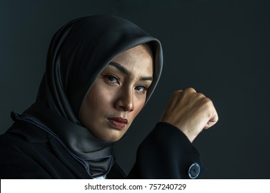 Muslimah fighter with low light view.