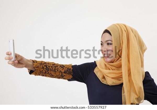 musliman using her smartphone self portrait