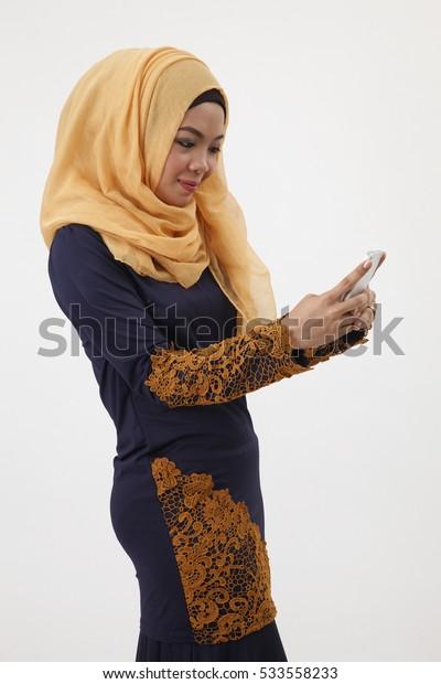 musliman using smart phone sending sms